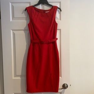 Red belted sheath dress.